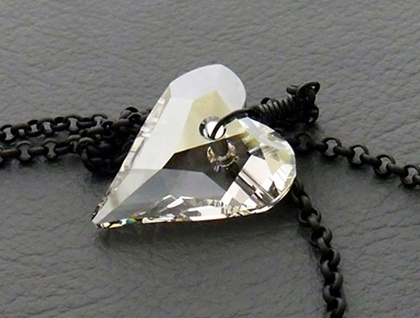 Rainy Heart necklace: sparkly, Swarovski crystal heart pendant in silver-grey on matte black chain