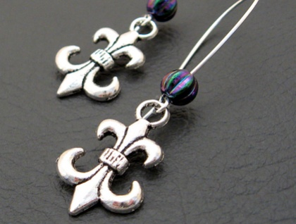 The Purple Jester earrings: antiqued silver fleur-de-lys with iridescent glass beads on silver ear-wires