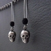 Skulls And Coal earrings: antiqued silver skull charms on long ear-wires, with black matte glass beads