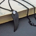 Raven At Midnight necklace: black wing pendant with shimmering moonstone on black chain