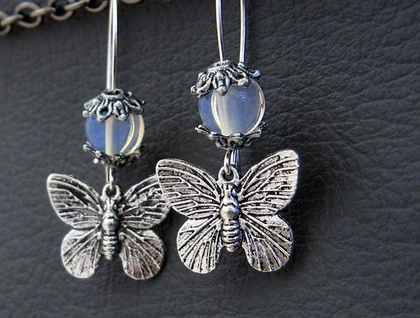 Moths In Moonlight earrings: silver moth charms with moonstone beads on silver ear-wires