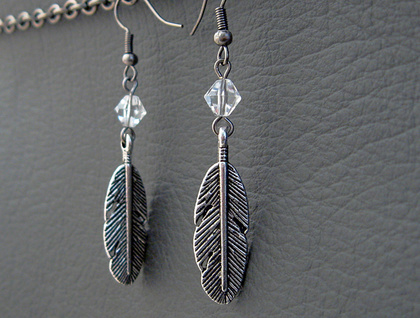 Horsefeather earrings: silver feather charms with clear crystals – myth-inspired earrings