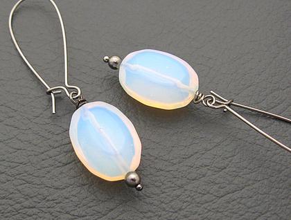Sea Opal earrings: moon-like glass ovals on long black earwires