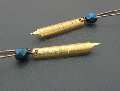 Pen And Ink earrings: real brass pen-nibs with inky blue Czech glass