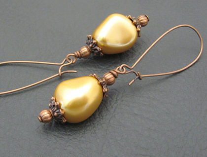 Golden Silk earrings: gleaming gold faux pearls with antiqued copper ear-wires