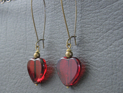 Ruby Heart earrings: deep red glass hearts with a stony edge, on long ear-wires