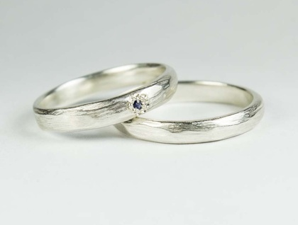 Pair of narrow carved rings in Sterling Silver, with Ceylon Sapphire