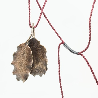 Large bronze Pittosporum leaves necklace on burgundy cord