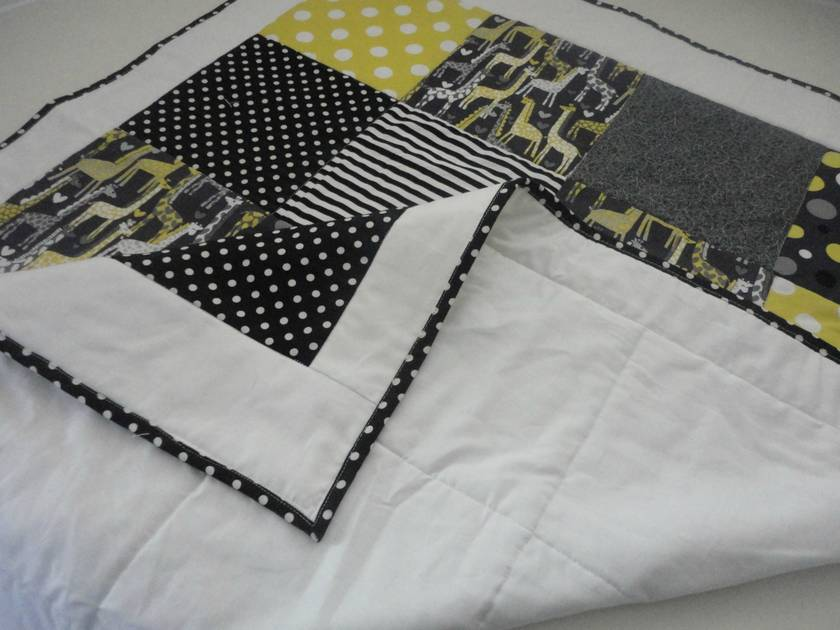 Contemporary Quilt for Cot or Crib featuring cute Giraffes