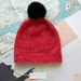 Hudson dark pink knitted beanie - luxury merino wool hat with upcycled fur pompom