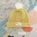 Hudson bright yellow slouch beanie - luxury merino wool hat with upcycled fur pompom
