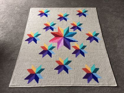 Wonderful handmade crochet blanket, Carpinter's Wheel design - stars in rainbow colours, textured.