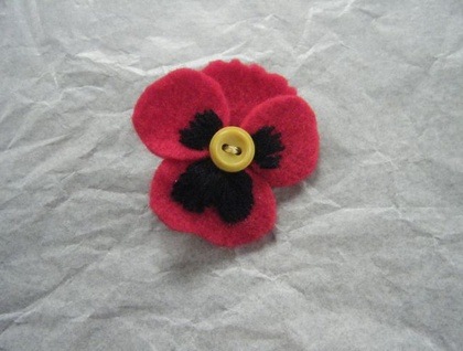 Red felt embroidered pansy brooch