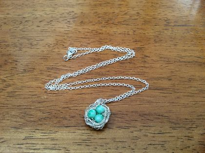 Dainty turquoise and silver bird's nest pendant