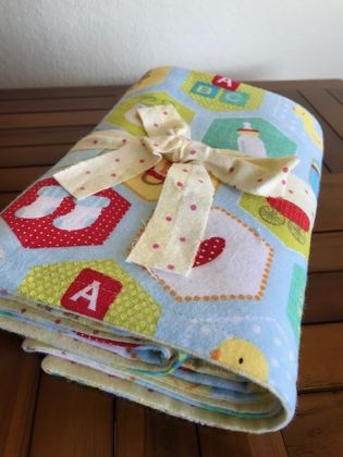Flannel blanket with burp cloths