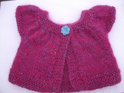 Knitted short-sleeved doll's cardigan