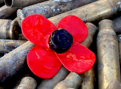 Trench Art brass poppy .223 hand painted red