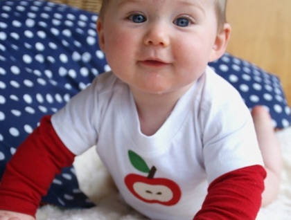 Cute baby in an apple t-shirt