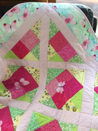 butterfly quilt for baby's cot or snuggle blanket.