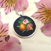Miniature hand embroidered pendant