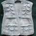 Tabard (waistcoat) for a baby.