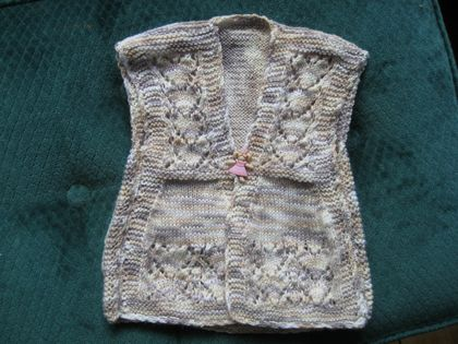 Tabard style top for a baby.