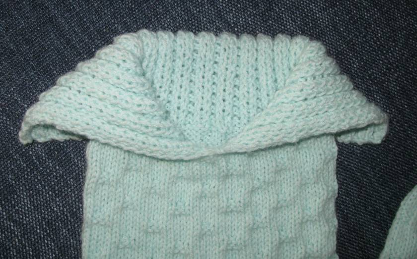 Cuddle sack and beanie for a newborn