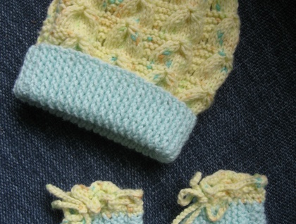 Baby bunting or sleep sack- dressing gown type with beanie and booties to match.