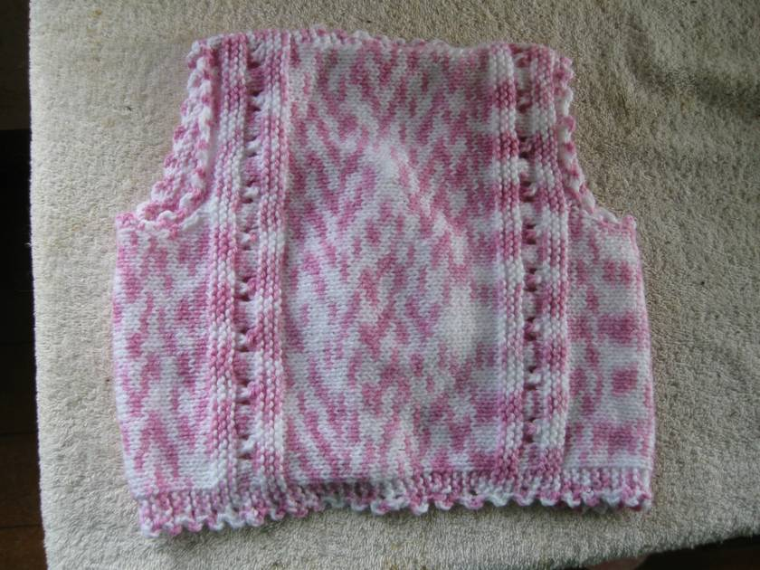Girls pink and white waistcoat or sleeveless vest