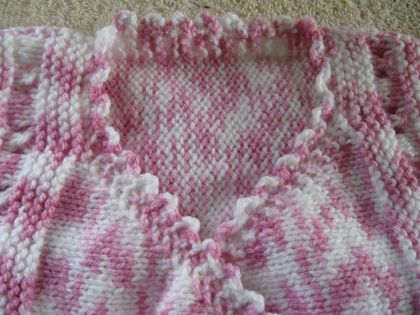 Girls pink and white waistcoat or sleeveless vest