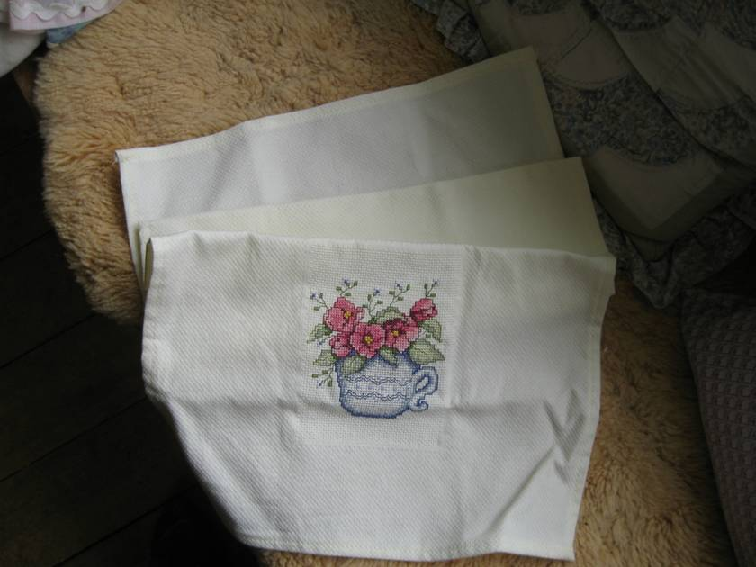 Towel with Cross stitched inset.