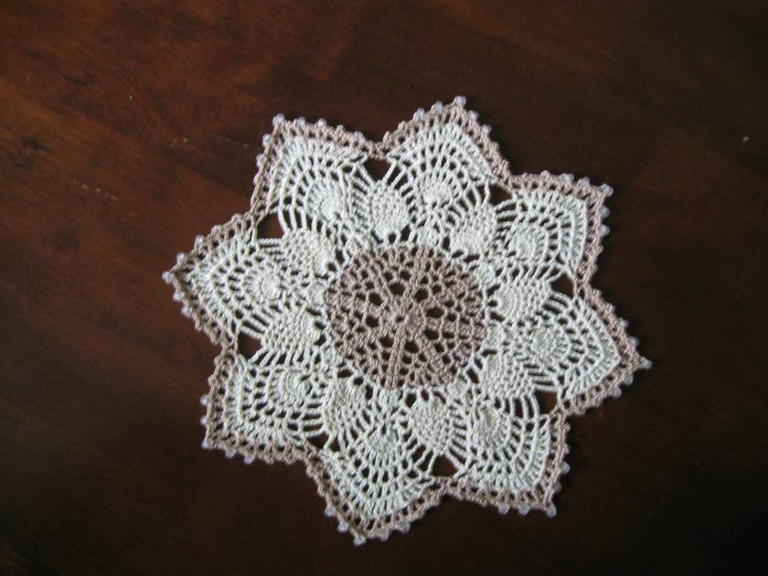 Crocheted pineapple doilies trio