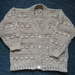 Patterned v neck cardigan for a 2-4 year old.