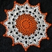 Crocheted doily with beads