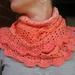 crocheted gradient yarn shawl in apricot tones
