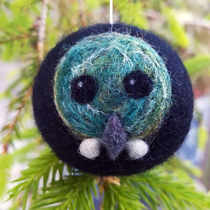 Felted wool decoration - tui