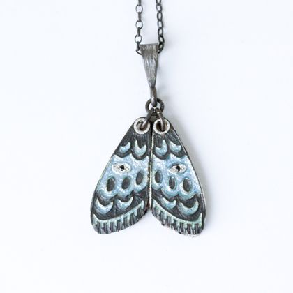 Hand engraved and glass enamelled gypsy moth pendant in fine silver