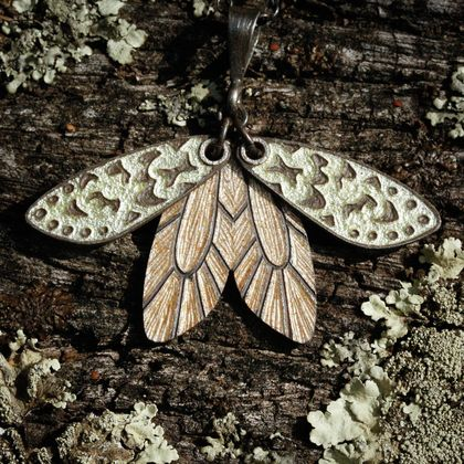 Hand engraved and glass enamelled lichen moth pendant in fine silver