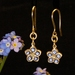 Solid gold and sapphire forget me not earrings