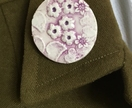 Lilac coloured floral ceramic brooch