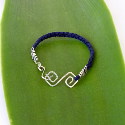 Mens Eco Sterling Silver Infinity Bracelet on Braided Blue Suede