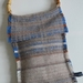 Hand-woven bag with bamboo handle