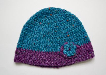 Lupin and turquoise crocheted hat with flower detail