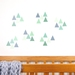 Jungle green triangles medium – reusable fabric wall decal