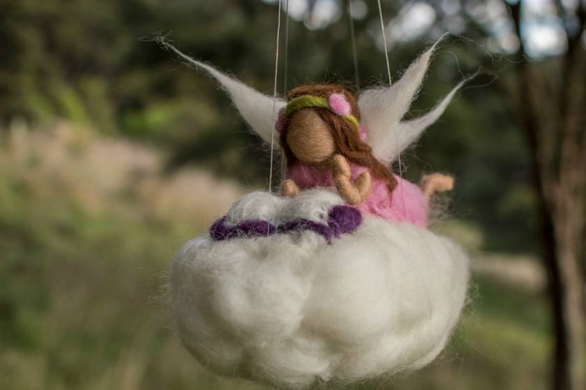 Fairy Reading on Her Cloud Mobile