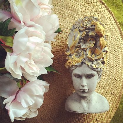Gorgeous vintage inspired concrete lady with a floral headpiece