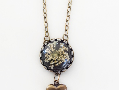 Flower & Heart Pendant - A funky combination of Brass & Black