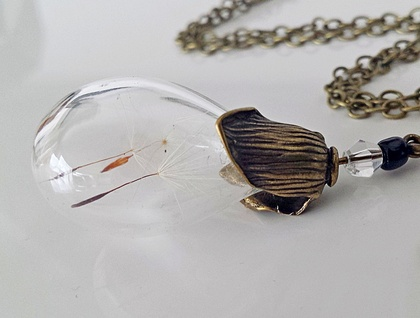 A few wishes in a small glass Bulb with a Petal top - Available in Brass or Silver