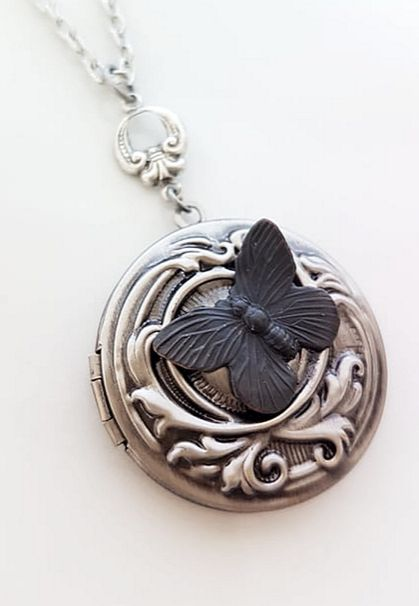 Antiqued Detailed Locket with a Vintage Black Butterfly