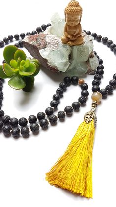 Strength and courage - 108 hand knotted mala with golden yellow tassel